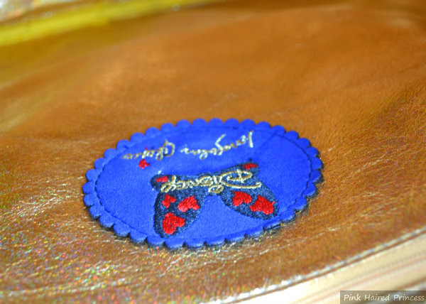 irregular choice whoa bag disney brand label and zipped inner pocket