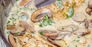 Mushroom Chicken With A Creamy Garlic And Parmesan Sauce