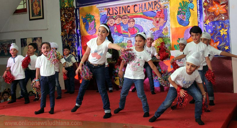 Students performing dance on stage during class presentation rising champs at BCM School