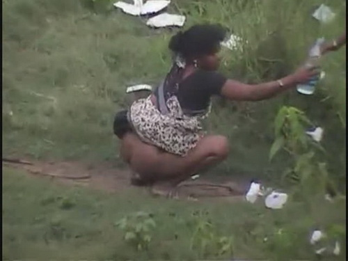 woman pooping in public