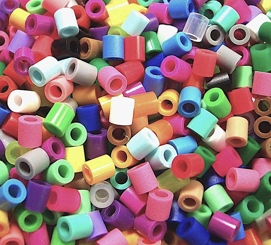 plastic tube beads, a close up color photograph