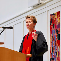 Rev. Jenny Shultz-Thomas preaching at a pulpit