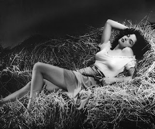 "Jane Russell reclining in pose accentuating her bosom from the then scandalous scene from ""The Outlaw"""