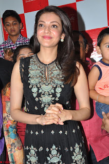 Kajal Aggarwal in lovely Black Sleeveless Anarlaki Dress in Hyderabad at Launch of Bahar Cafe at Madinaguda 009.JPG