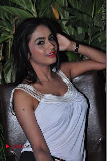 Actress Model Pooja Sri Stills in White Short Dress at F Club pre soft Launch  0198.JPG