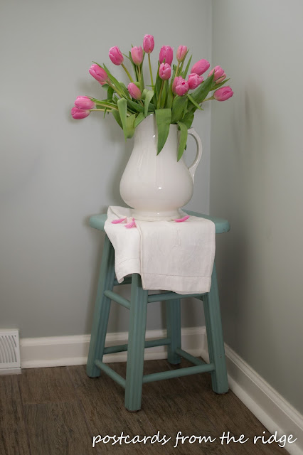 Pretty Pink Tulips in a vintage white pitcher. Postcards from the Ridge