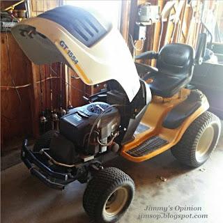 Cub Cadet GT1554 sitting inside garage with hood raised
