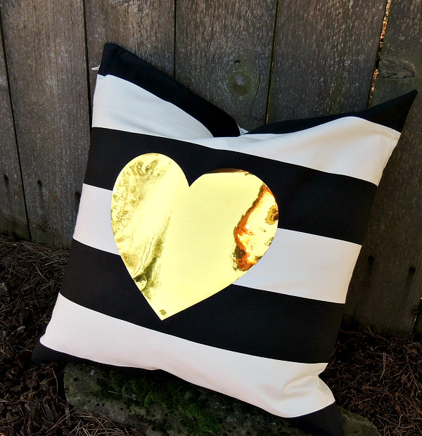 Gold heart striped pillow