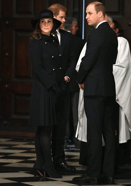 Duchess Catherine -Kate Middleton wore a double wool coat by Carolina Herrera. Jimmy Choo Georgia shoes.
