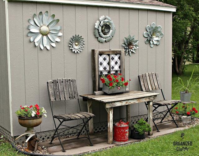 Decorating a Home Depot Shed Kit with JUNK #junkgarden #gardenjunk #flowergarden #containergarden #oldsignstencils #stencils