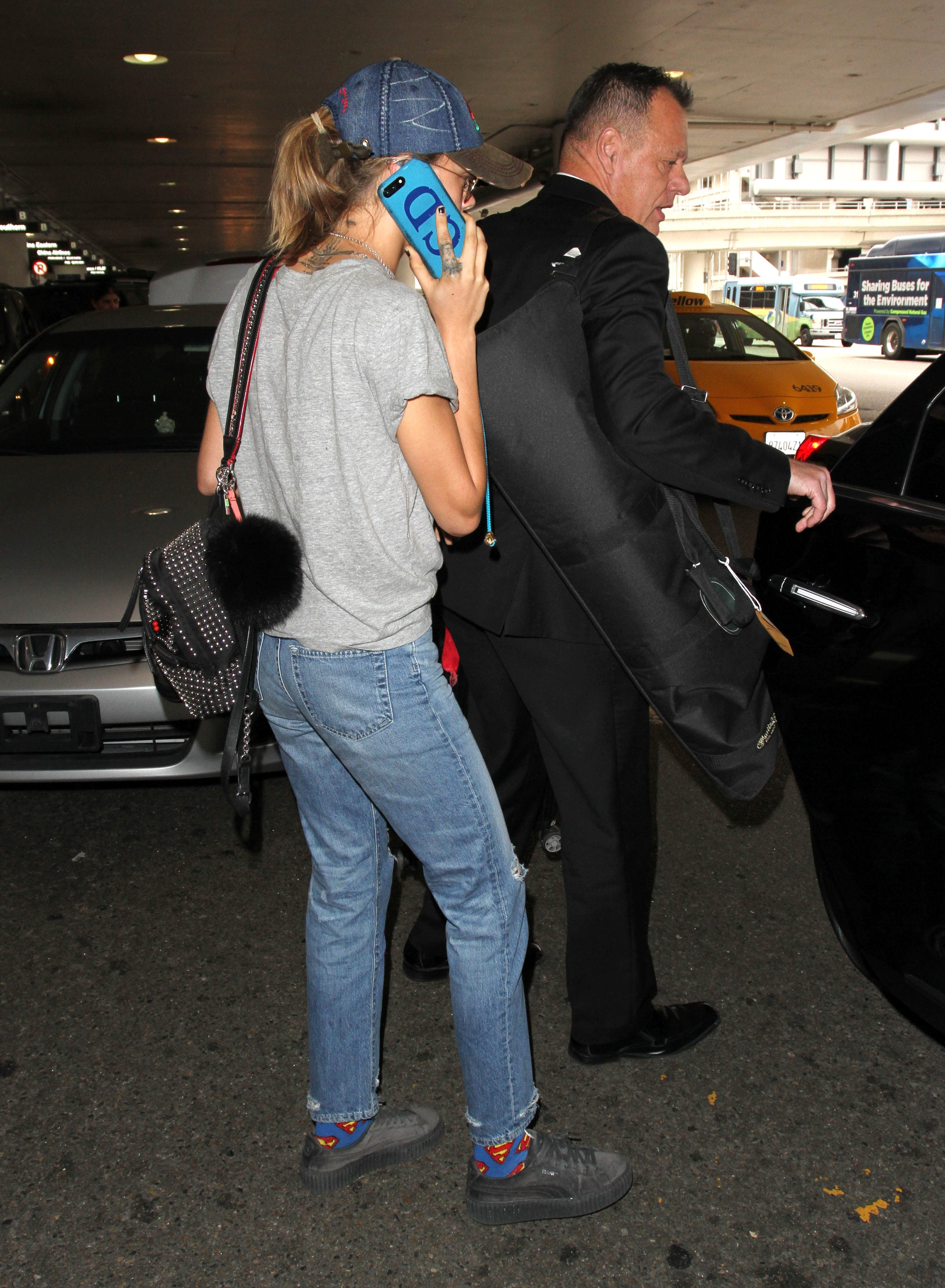 Cara Delevingne talking on phone when at out