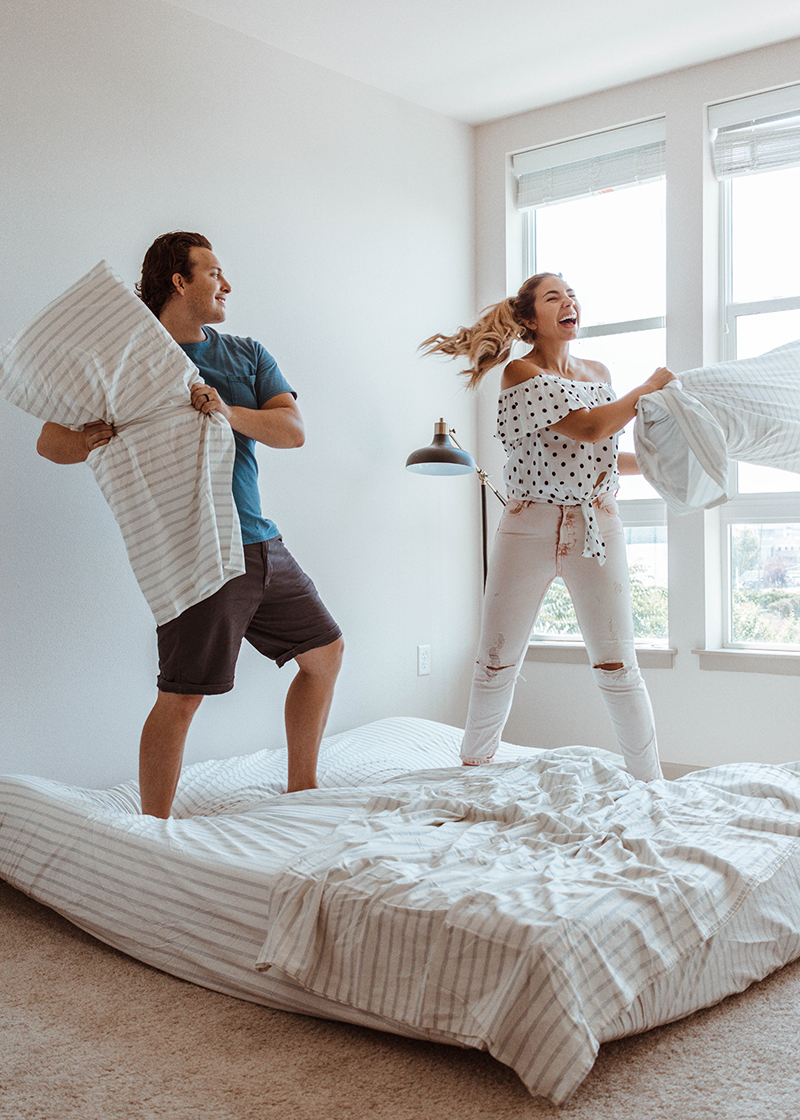 married couple pillow fighting, pillow fight, marriage