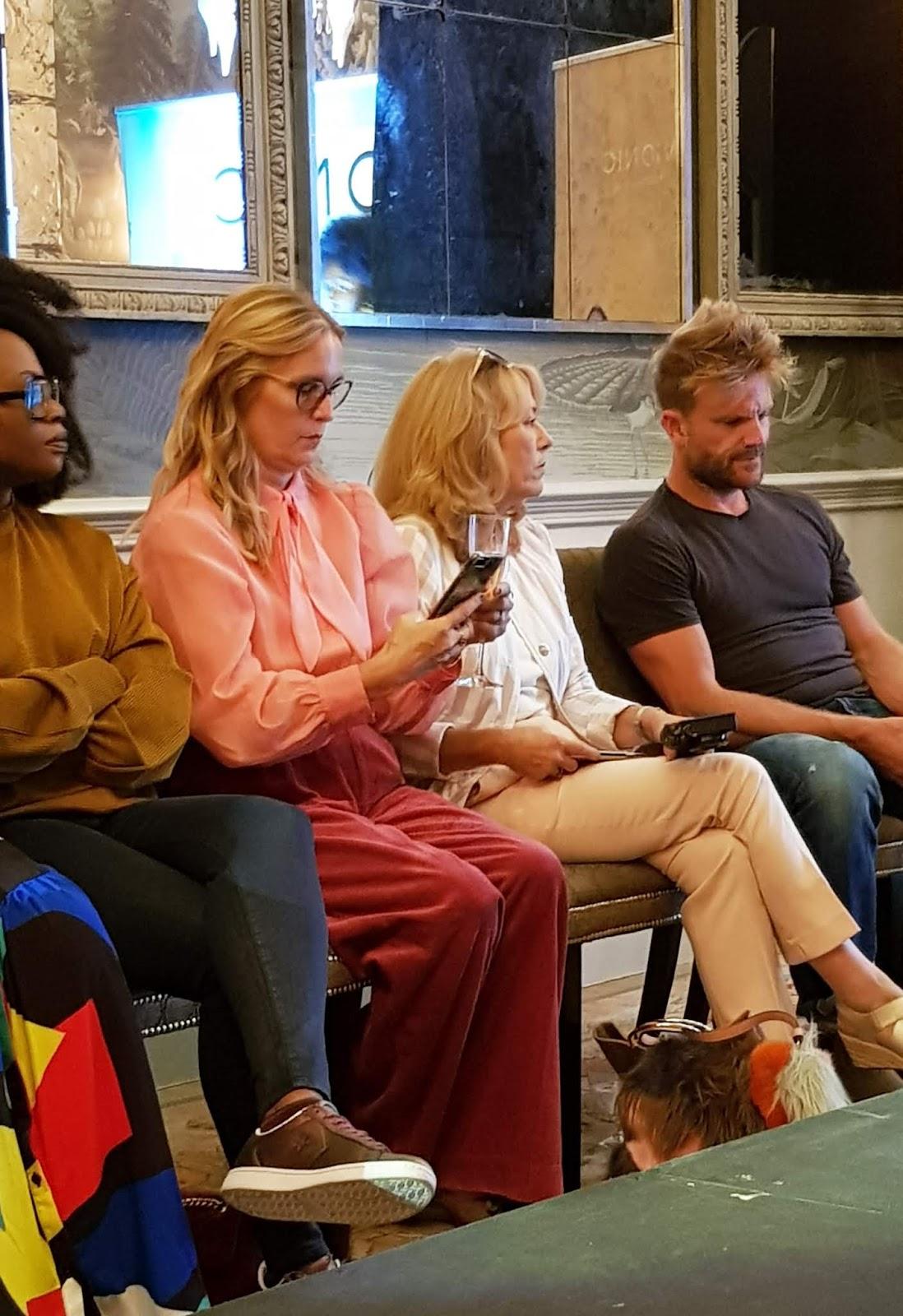 Image showing women bloggers along the runway of a show fashion show run by Vionic UK in London