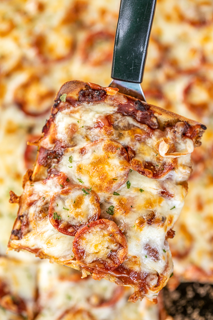 Crazy Crust Pizza - our new favorite pizza!! No rolling out dough - the crust is made from a liquid batter. Top the pizza with your favorite toppings. Flour, salt, Italian seasoning, eggs, milk, pepperoni, sausage, ham, pizza sauce and mozzarella cheese. We LOVE this pizza! We've been making it once a week for the past month. It is our go-to recipe!! #pizza #casserole
