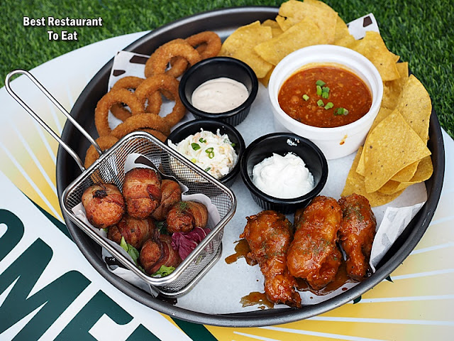 Morganfield Menu FourPlay Bacon wrapped meatballs,