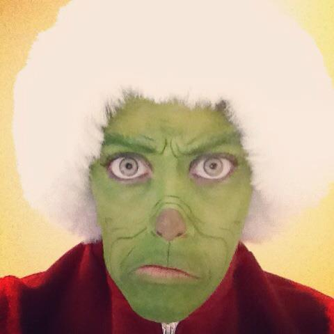 Carly Paige made up as The Grinch