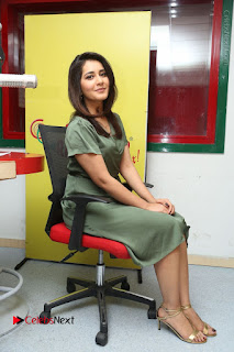 Actress Raashi Khanna Stills in Green Short Dress at Mirchi 95 Suno Aur Mercedes Jeeto Contest  0146.JPG