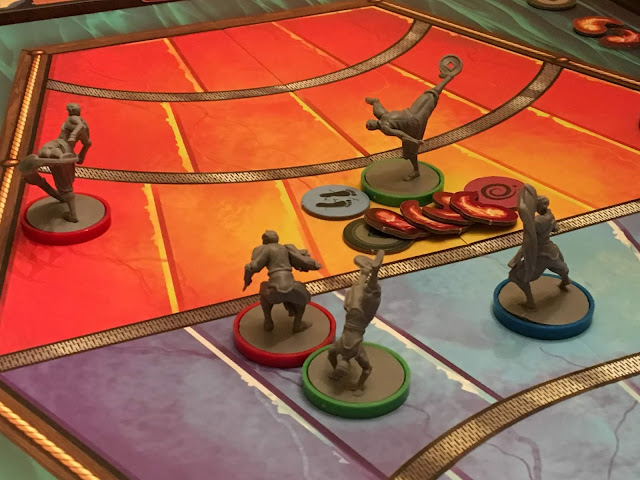 Gameplay in Legend of Korra Pro-Bending Arena by IDW Games. Review and photo by Benjamin Kocher at Everything Board Games