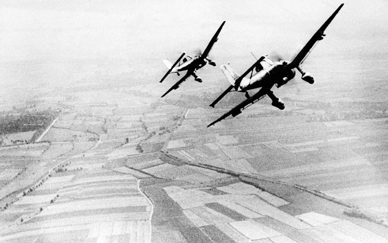 Two German Luftwaffe Ju 87 Stuka dive bombers return from an attack against the British south coast, during the Battle for Britain, on August 19, 1940.