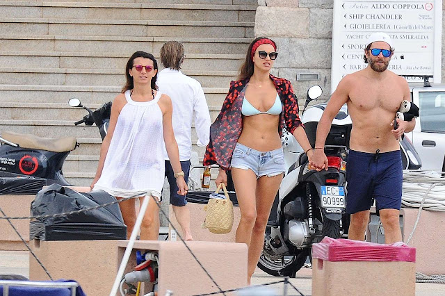 Irina Shayk in Bikini Top at a dock in Sardinia