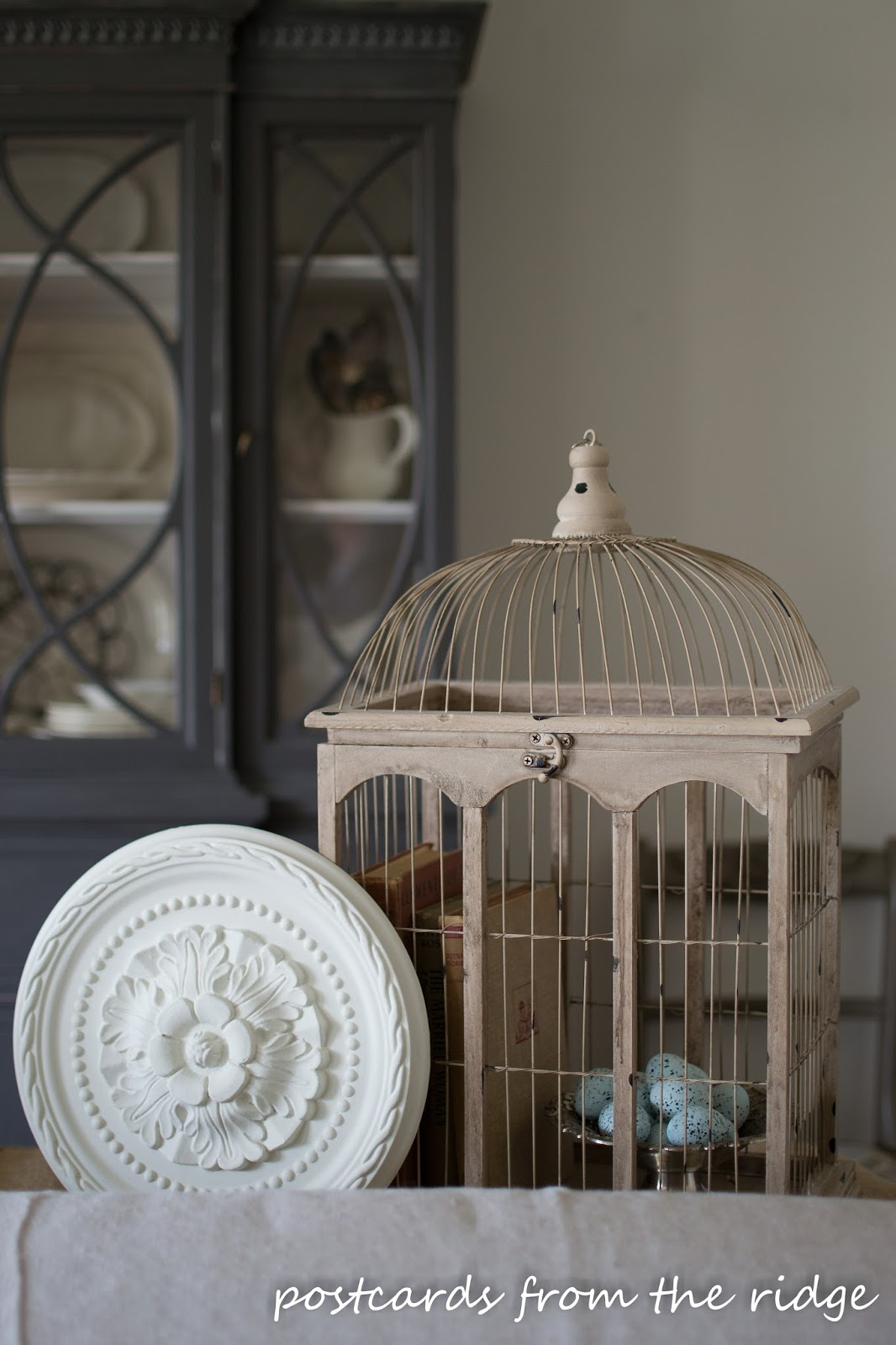 ceramic bird eggs in a bird cage