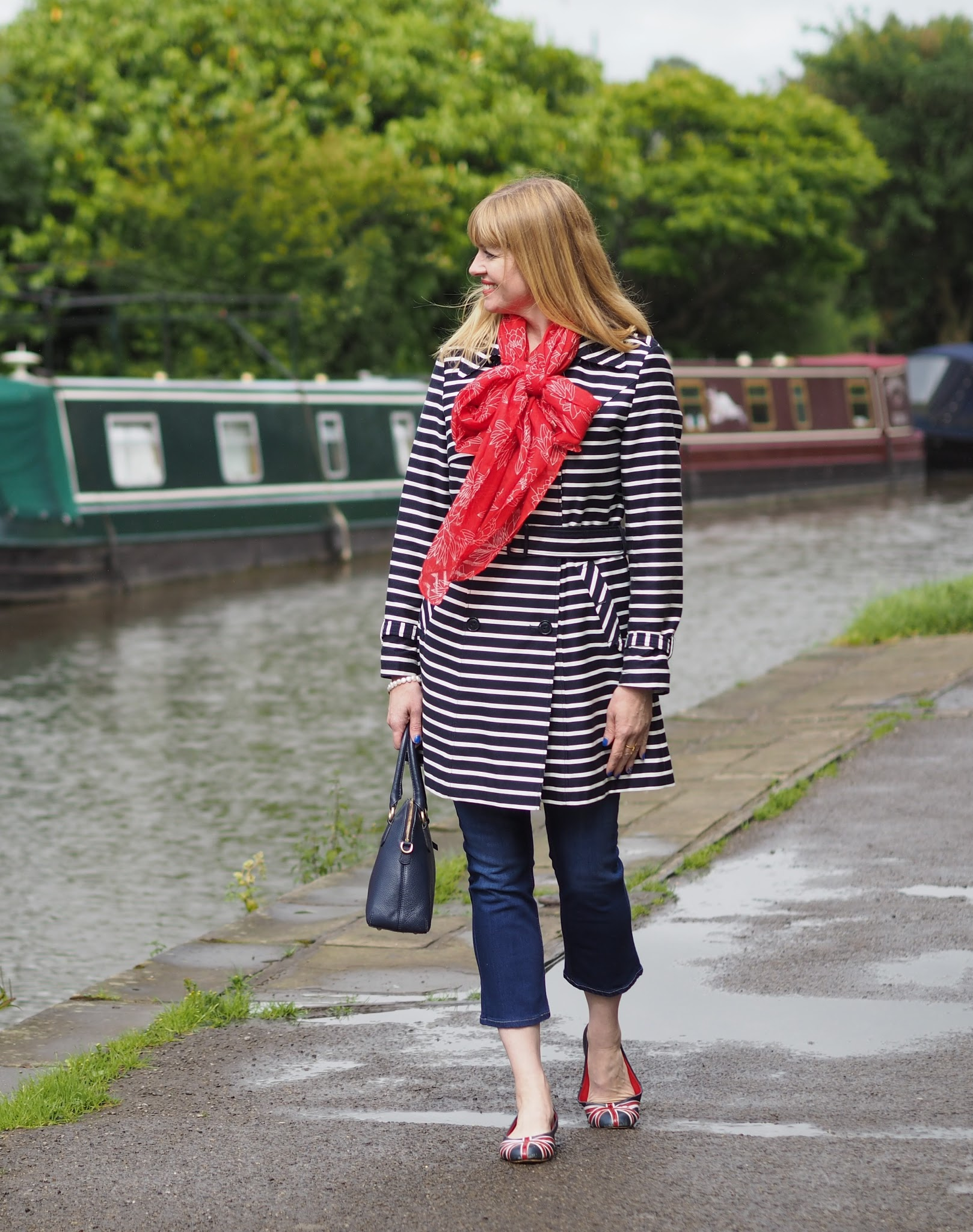 Navy striped trench coat, red floral scarf and British union jack ballerina shoes