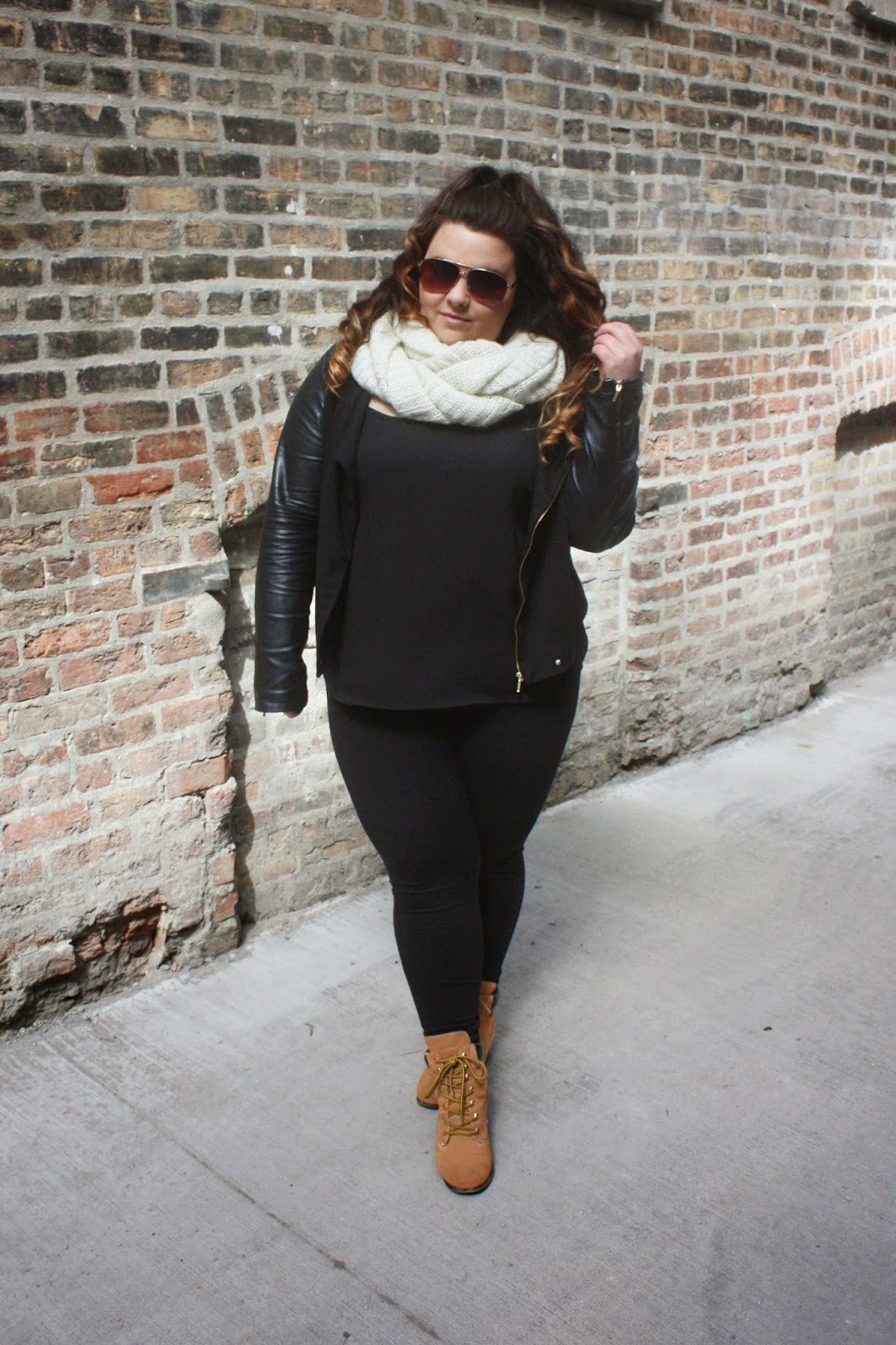 black spring wardrobe, natalie craig, natalie in the city, chicago, plus size fashion, fatshion, fashion blogger, leather jacket, contrast sleeves, half up hair, ariana grande hair, timberlands, timberland heels, all black everything, infinity scarf, aviators, curvy women, bbw, outfits with leggings, curly ombre