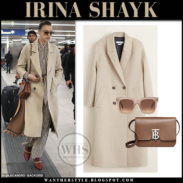 Irina Shayk in beige wool Mango coat with brown shoulder Burberry TB bag. Fashion week airport style february 2019