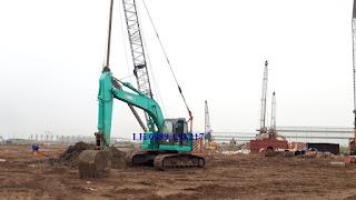 máy xúc đào SK235