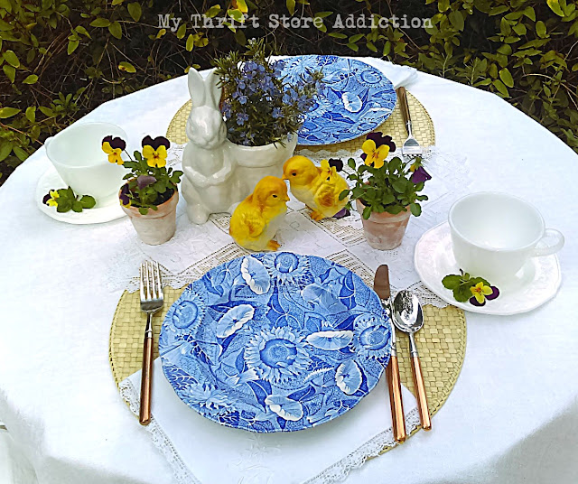 spring flowers blue and white garden table