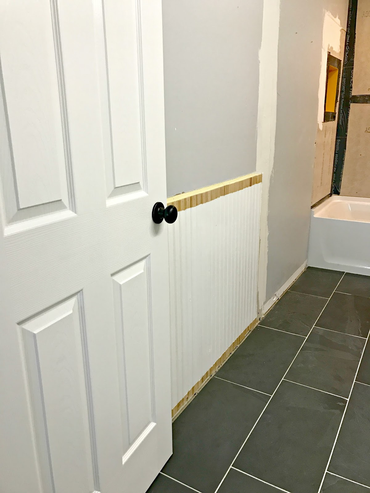 Bathroom next steps -- which wainscoting look? from Thrifty Decor Chick