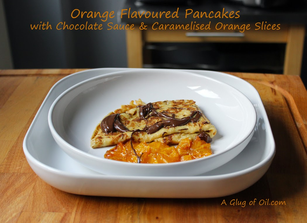 Orange Flavoured Pancakes with Chocolate Sauce and Caramelised Oranges