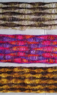 cross section of three scarves: three wavy stripe patterns in three different colour combinations (browns/greens, pink/orange/purples, browns/gold)