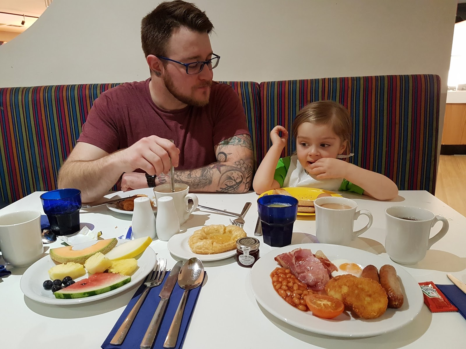 dad and daughter eating breakfast at butlins minehead