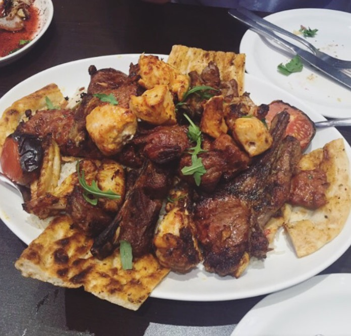 platter of kebab meat and breads