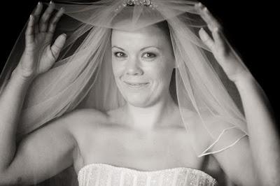Sleek bun under a cathedral length veil