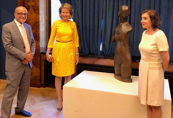 Queen Mathilde visited the Melancholia exposition held at the Villa Empain. The Villa Empain is a private house in the Art Deco style. Natan yellow lace dress