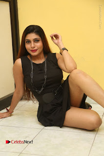 Tollywood Upcoming Actress Pooja Roshan Stills in Black Short Dress at Plus 1 Movie Trailer Launch  0255.JPG