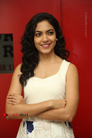 Actress Ritu Varma Stills in White Floral Short Dress at Kesava Movie Success Meet .COM 0072.JPG