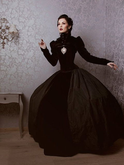 Women's victorian gothic steampunk black velvet gown. Perfect for steamgoth or dark fantasy and noir costumes. Dress from Victorian period