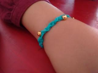 Top Ender wearing her bracelet