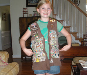 Girl Scout Earns All Brownie Patches Before Bridging To