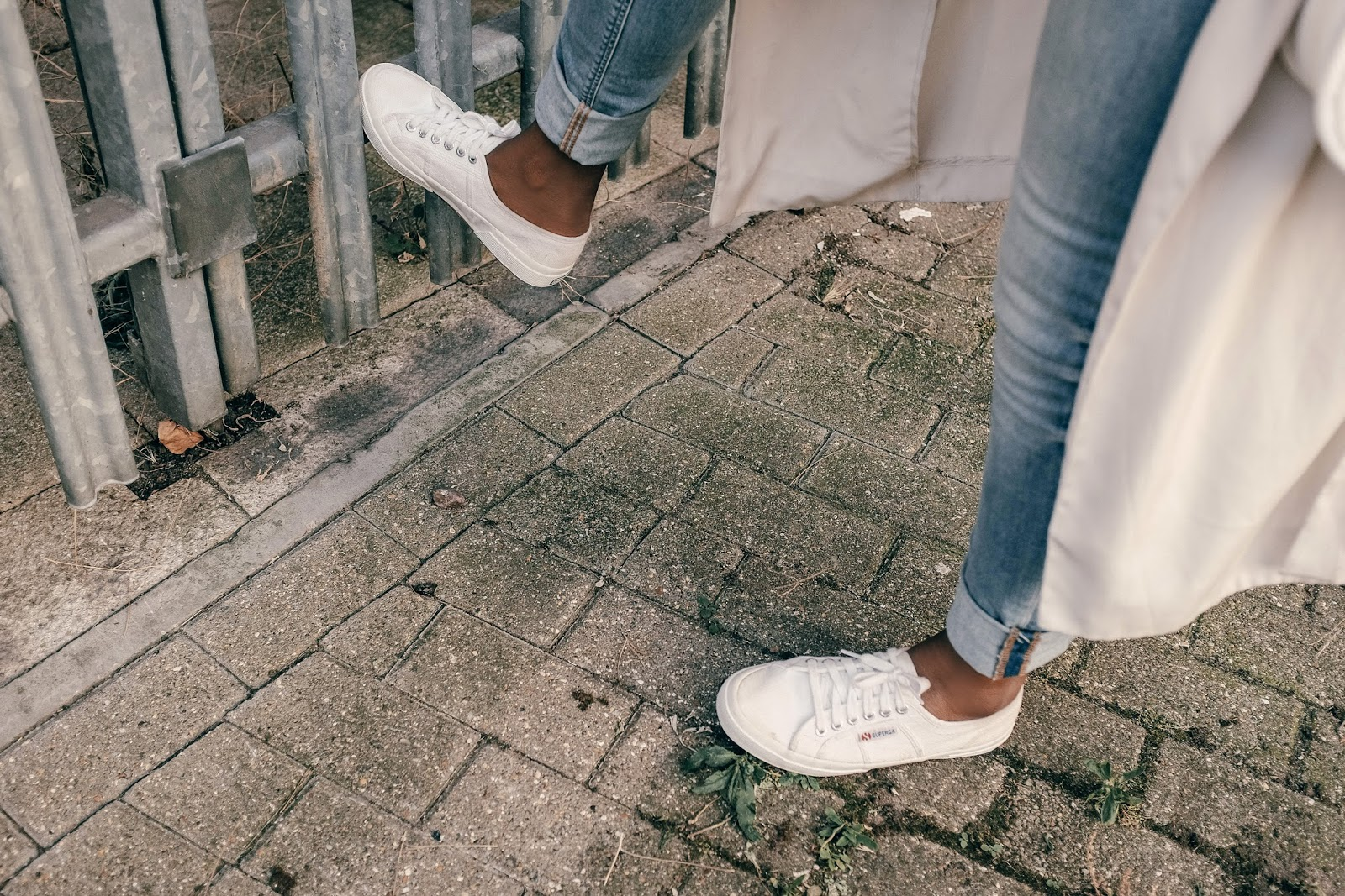 Fashion blogger wearing Classic 2750 superga trainers in all white