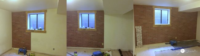 adding faux brick panels to the wall