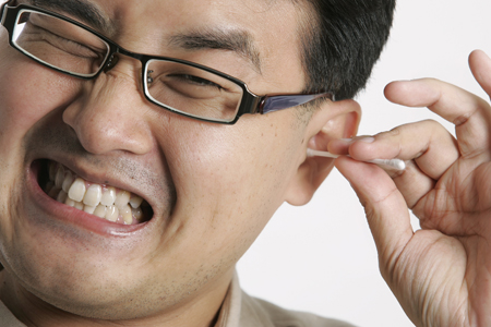 Cleaning your ears with a cotton bud