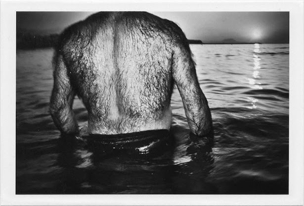 dirty photos - et - a black and white photo of hairy man's back