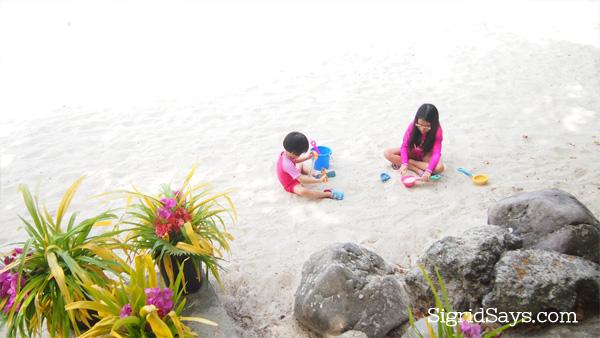 Building sand castles Dakak Beach Resort