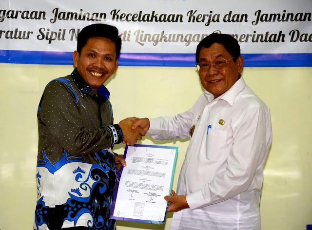 Kali Pertama di Lampung, Pemkab Mesuji Kerjsama PT Taspen Beri JKK-JKm Bagi Honorer