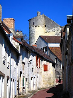 Narrow street in Le Grand-Pressigny with chateau in background