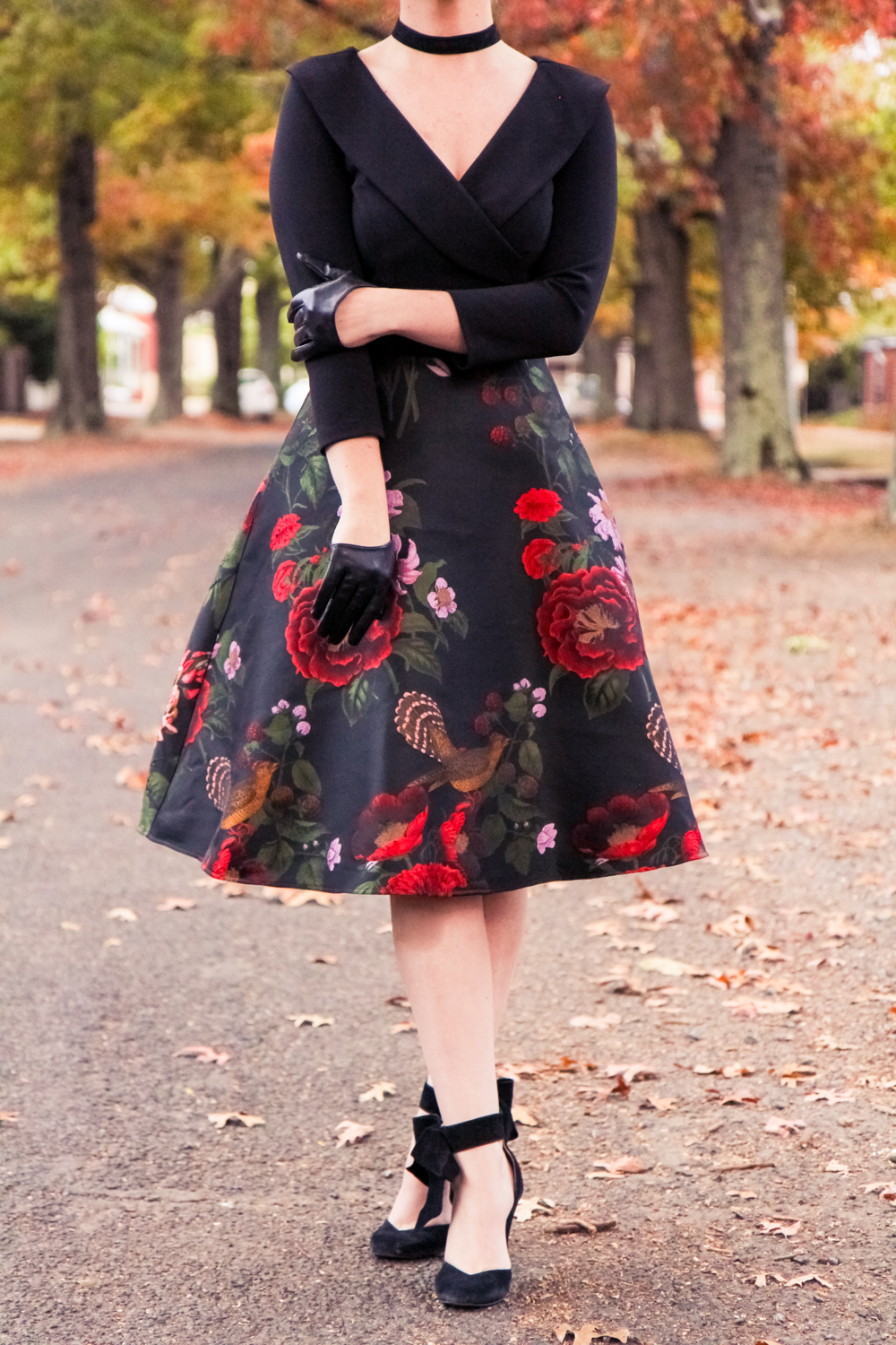 Liana of @findingfemme wears black floral Review dress